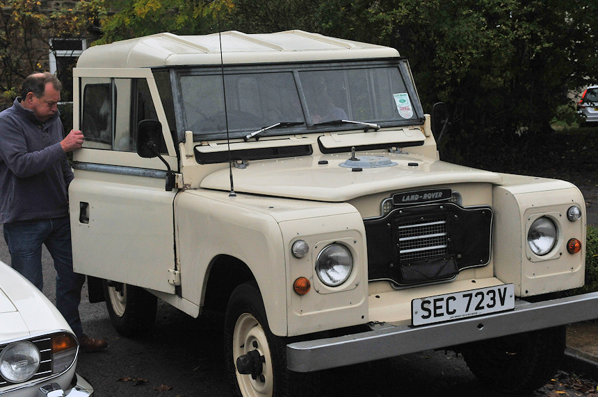 A white Land Rover Defender