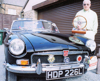Barry Horncastle with his black MGB roadster