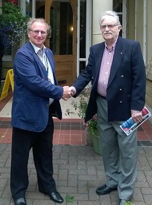 Photo of President Mike Lister making presentation to David Armitage